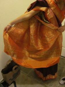 Pallu or ornage and purple sari